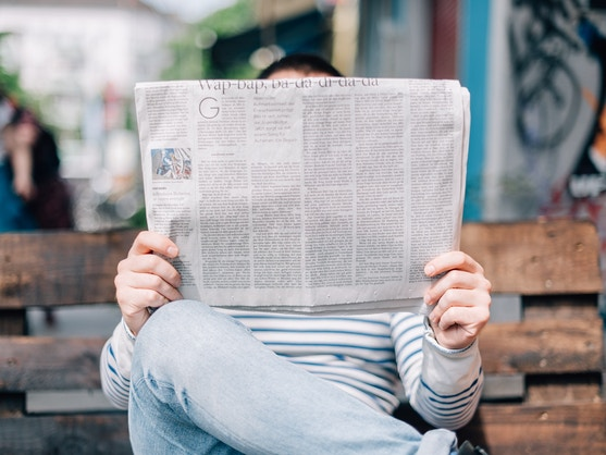 man reading a newspaper