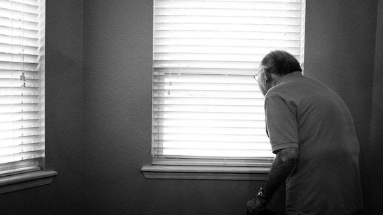 Older man in front of window