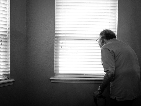 Older man in front of window